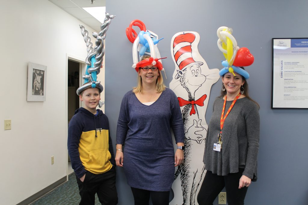 Windsor Wood Elementary School fourth-grader Graydon Ambrose, special education teacher Melinda Ambrose and library media assistant Jennifer Ramiro donned wacky hats in honor of Dr. Seuss.
