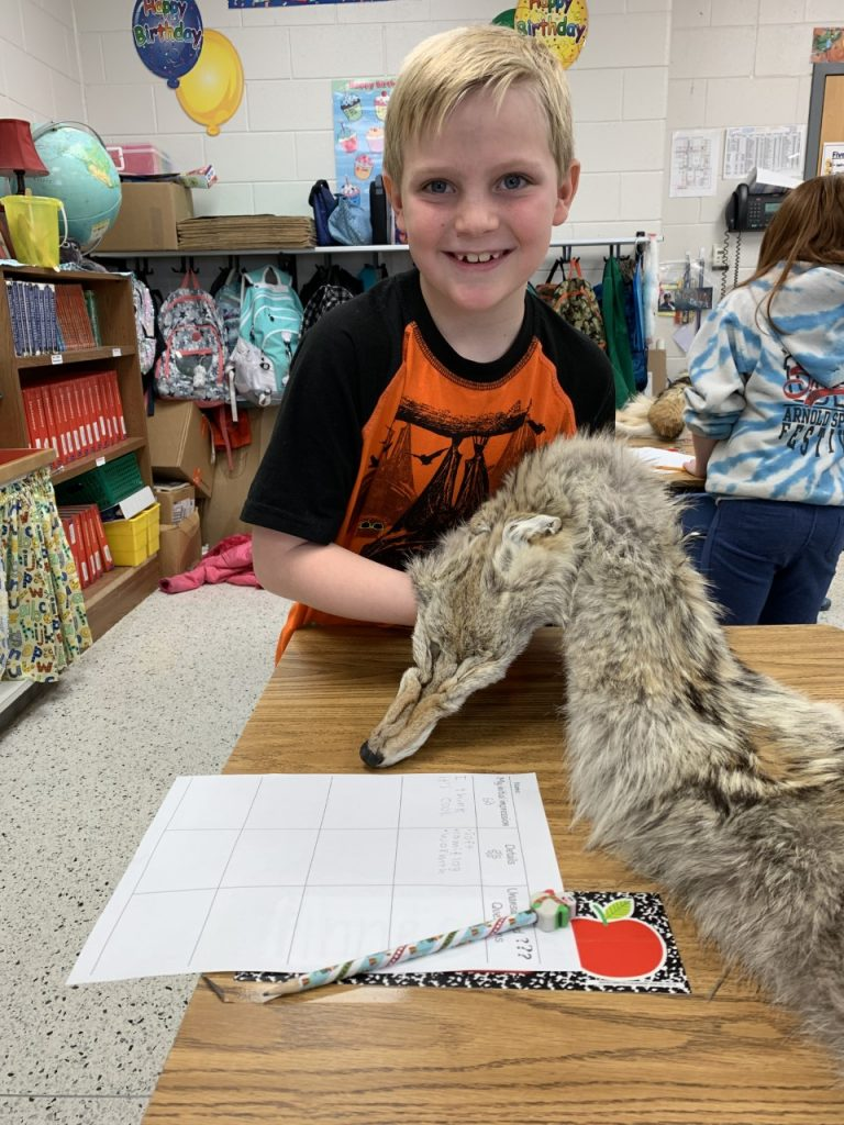 Jake Nolan, third grader at Woodstock Elementary, examined an animal fur during the Structures in Nature unit study.