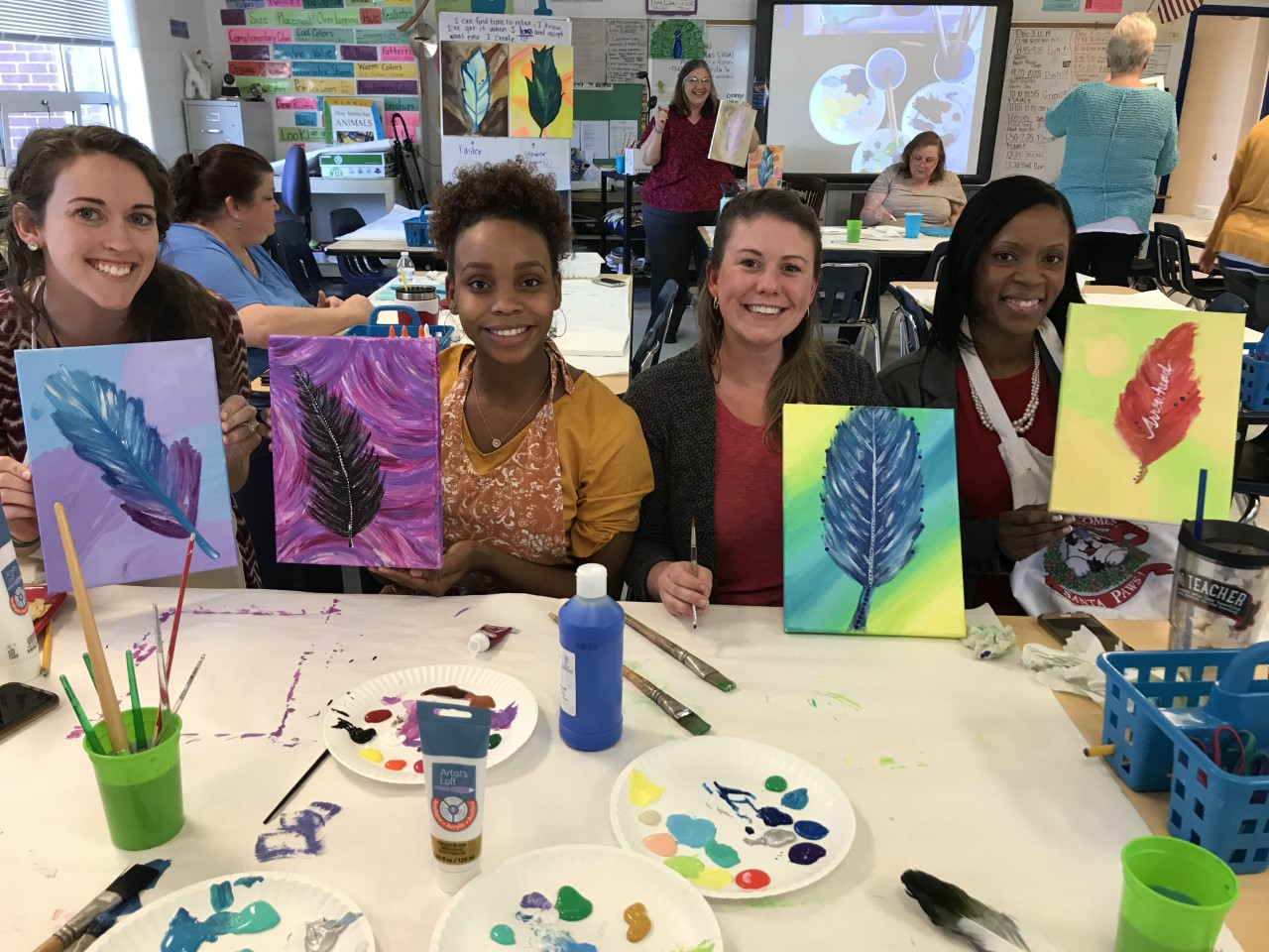 Lauren Curtis, Olivia Lowman, Julie Finucan, and Kimani Vaughan enjoyed a Paint Nite (afternoon) at Arrowhead Elementary School.
