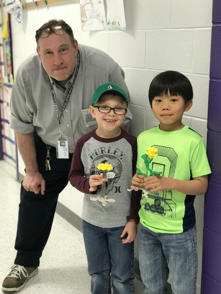 Arrowhead Elementary School first-graders Grant Early and Ethan Lee worked with ITS David Crouse to create prototypes of a plant with the 3D printer.