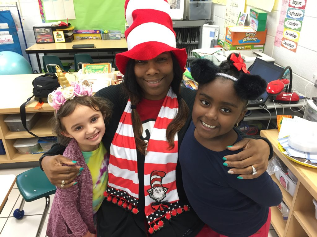 Diamond Springs Elementary first-graders Santina Morris and Madison Sutton celebrated Read Across America week with their teacher, Nicole Barclay-Boson.