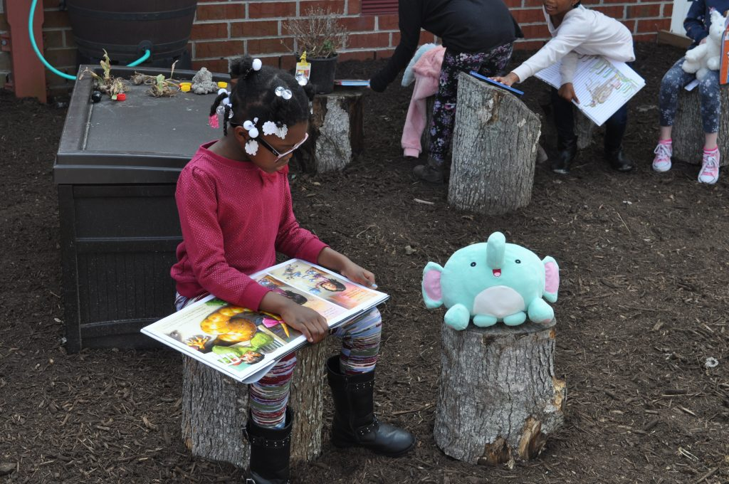 Newtown Elementary student Kyeasia Taylor celebrated Read Across America with a Snuggle Up And Read session.