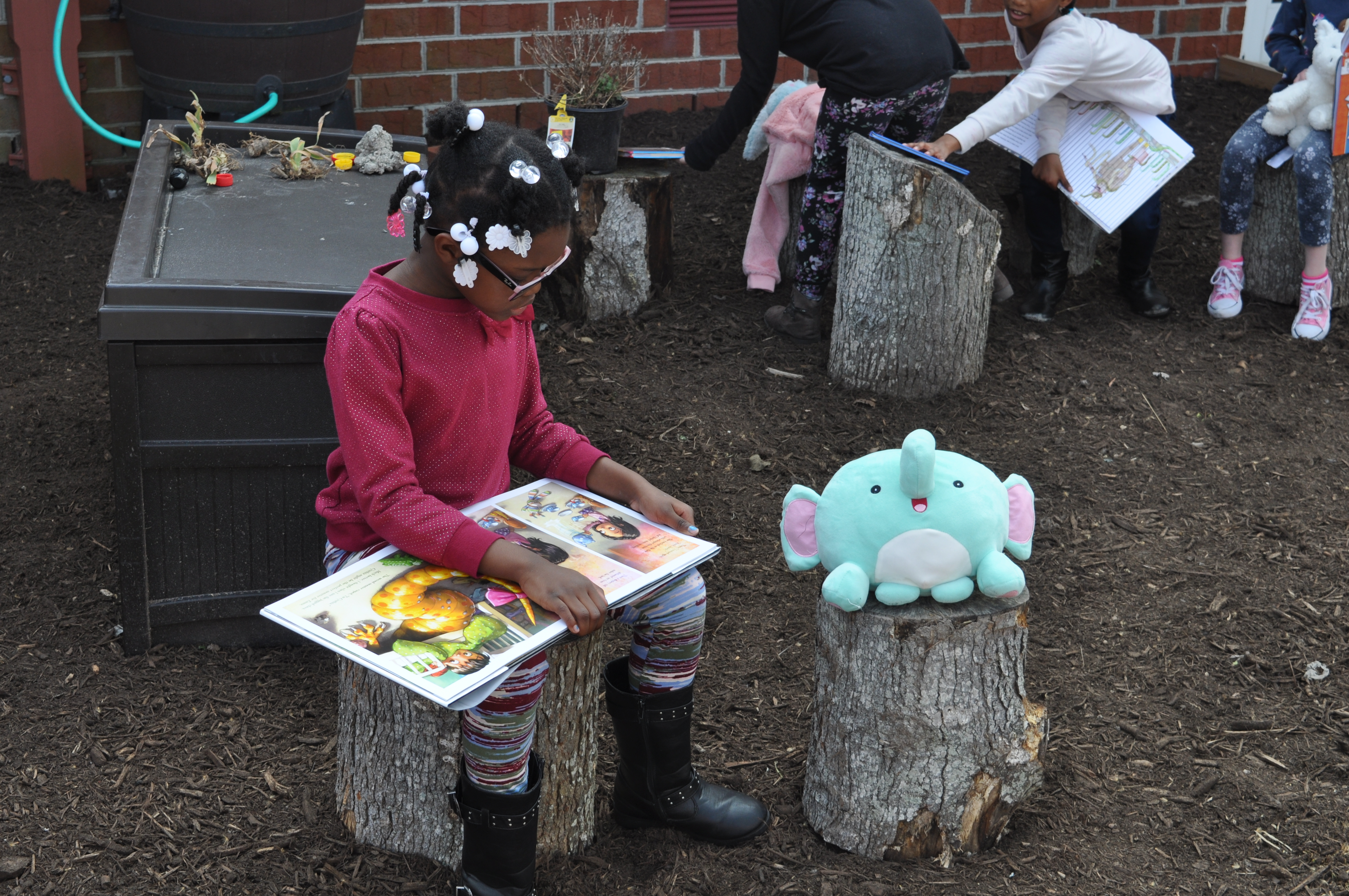 Newtown Elementary student Serenity Banks celebrated Read Across America with a Snuggle Up And Read session.