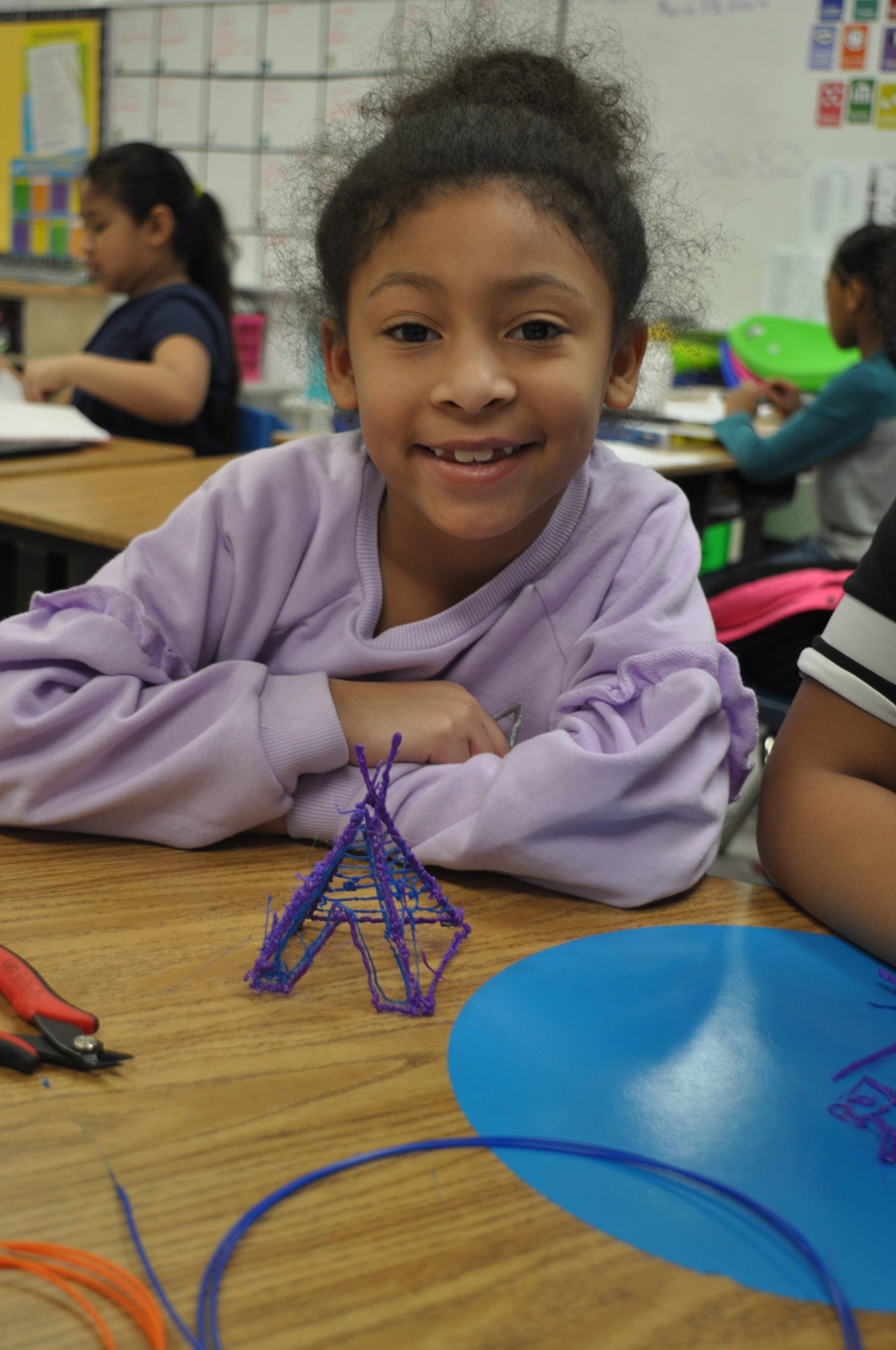 Newtown Elementary School student Jade Greene displays her knowledge of Native American tepees with 3D pens.