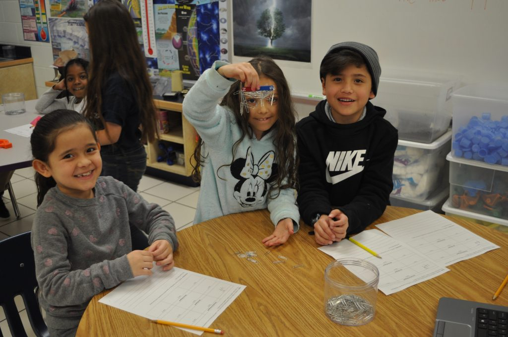 Newtown Elementary School students Nahiomy Soto Nunez, Maria Houghton, and Christian Rivera Quintana explored the concepts of magnetism and tested to see which magnet is strongest based on which one can pick up the most magnets.