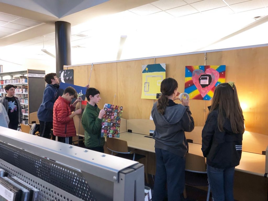 In celebration of Youth Art Month, eighth-grade art students from Old Donation School installed their own artwork in the Bayside Special Services Library.