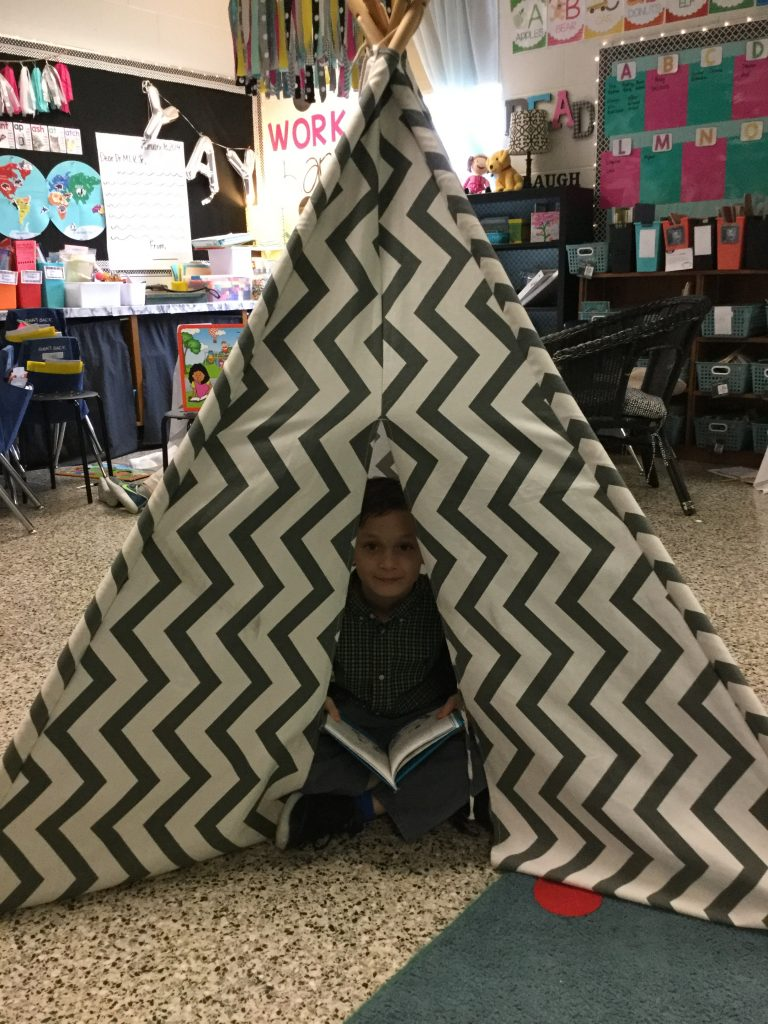 Princess Anne Elementary second-grader Kadyn Carolino camped out at Camp Bookworm to celebrate Read Across America.