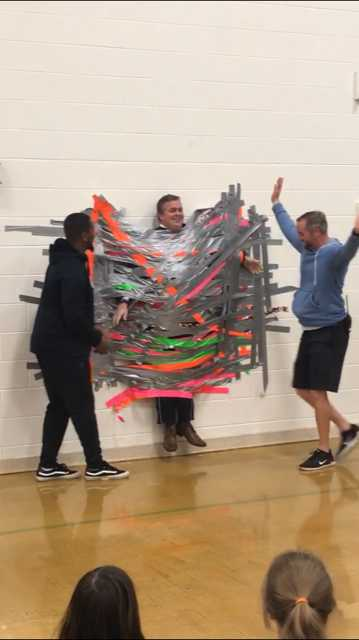 Providence Elementary School students took the Kids Heart Challenge during the month of February and raised $5,368 for the American Heart Association. Each student that met their goal of $5.00 earned a piece of tape to tape Principal Mike Taylor the wall.