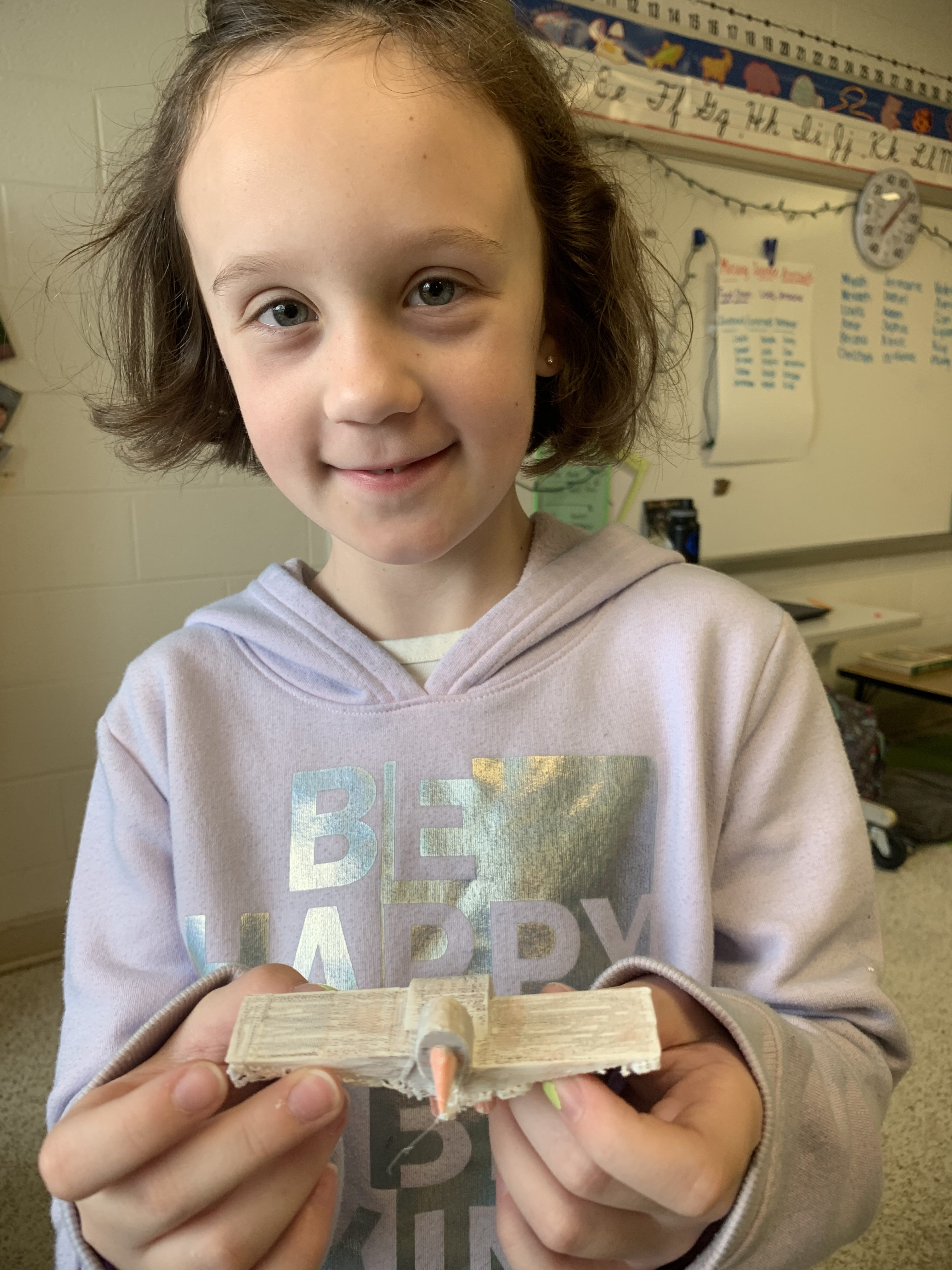 Provident Elementary School third-grader Samantha Farr shows off her osprey that she created using Tinkercad and printed on the 3D printer.