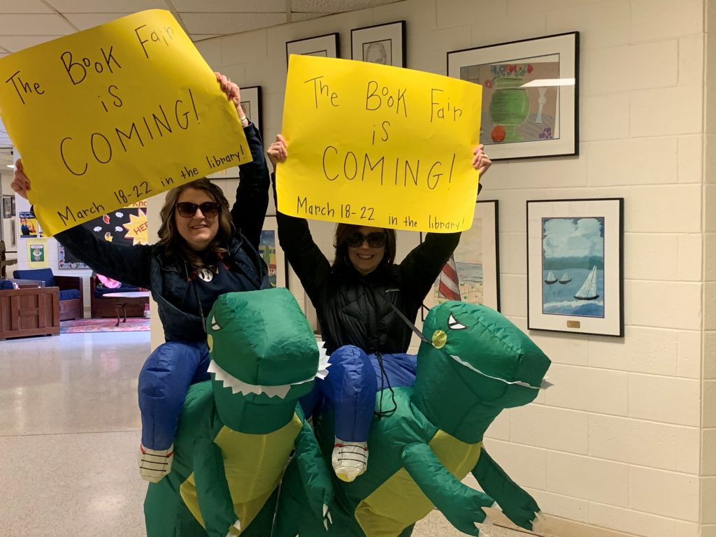 Providence Elementary Library Media Assistant, Lisa Ziegler and Library Media Specialist Erin Berens are walking advertisementts for the Book Fair coming March 18.