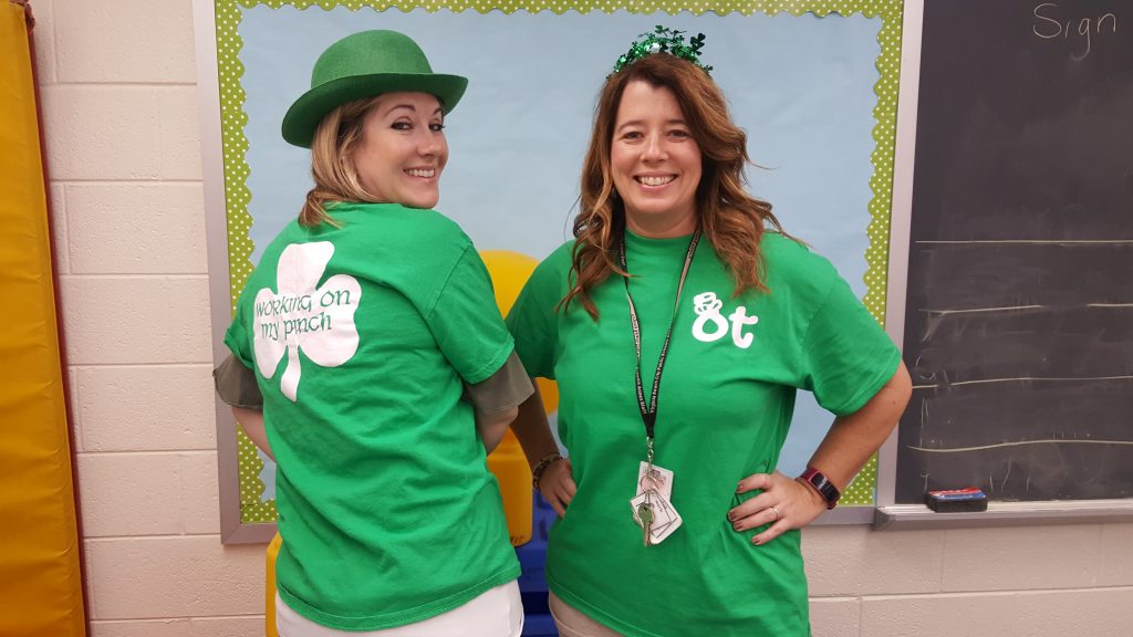 "Special Education Annex occupational therapy staffers Anne Marie Briggs and Angie Miller, are getting into the St. Patrick's spirit this week by sporting lighthearted shirts indicating that they are ""working on their pinch"". Pinching activities are commonly used in occupational therapy sessions to help students develop hand strength and refine their grasp for functional activities such as writing."