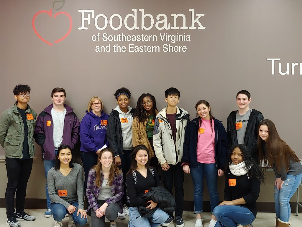 Tallwood High School National Honor Society students spent a morning helping distribute food at the Food Bank of Southeastern Virginia as part of their focus on hunger solutions.