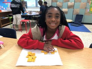 Ava Hawthorne, third grader at Malibu Elementary School, used crackers to learn area and perimeter.