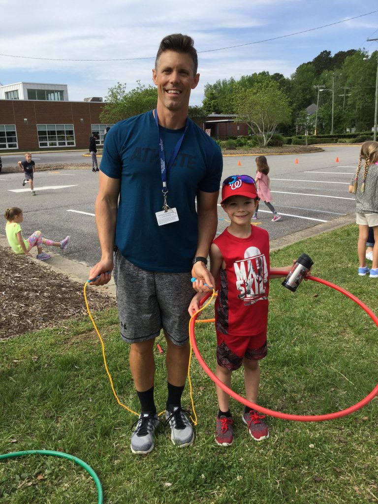 Princess Anne Elementary physical education teacher, Chris Sanders helped second grader Aiden Shephard prepare for the Kids Heart Challenge. Students raised over $12,000 to support heart health.