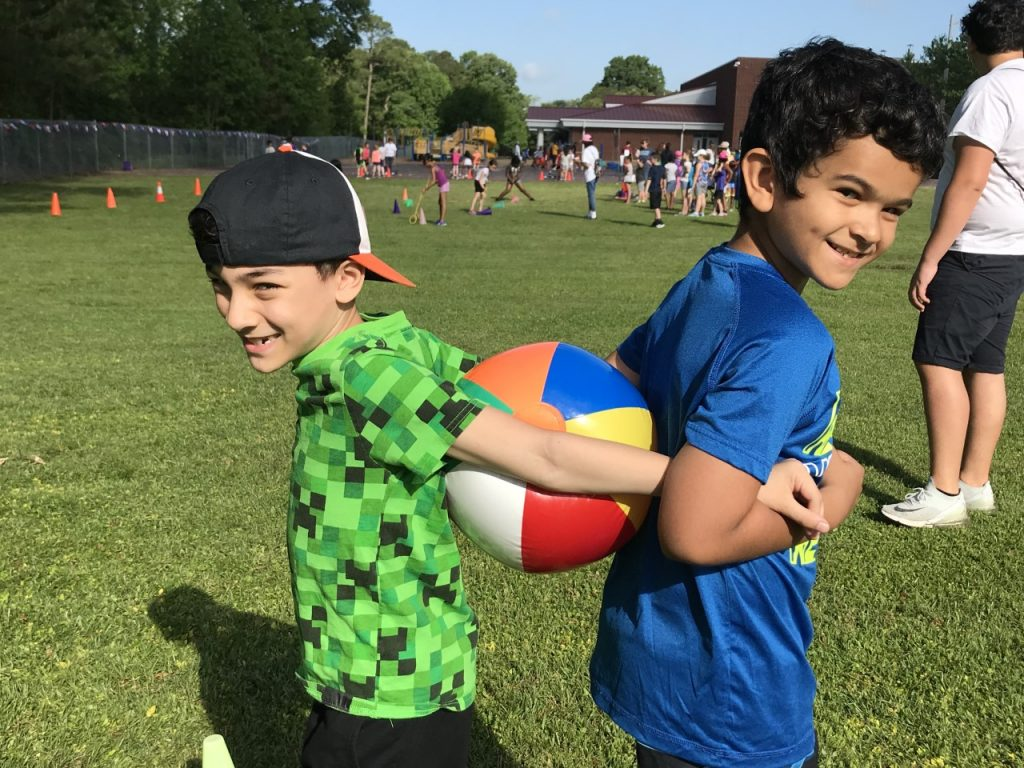 Arrowhead Elementary School third graders Luca Munoz and Soulayman Yamoune took part in the beach ball relay during Field Day.