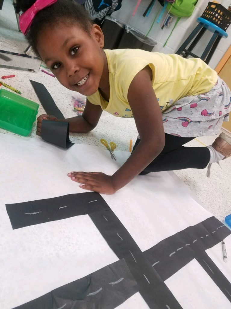 Arrowhead Elementary School first grader Micah Napper works on her town map.