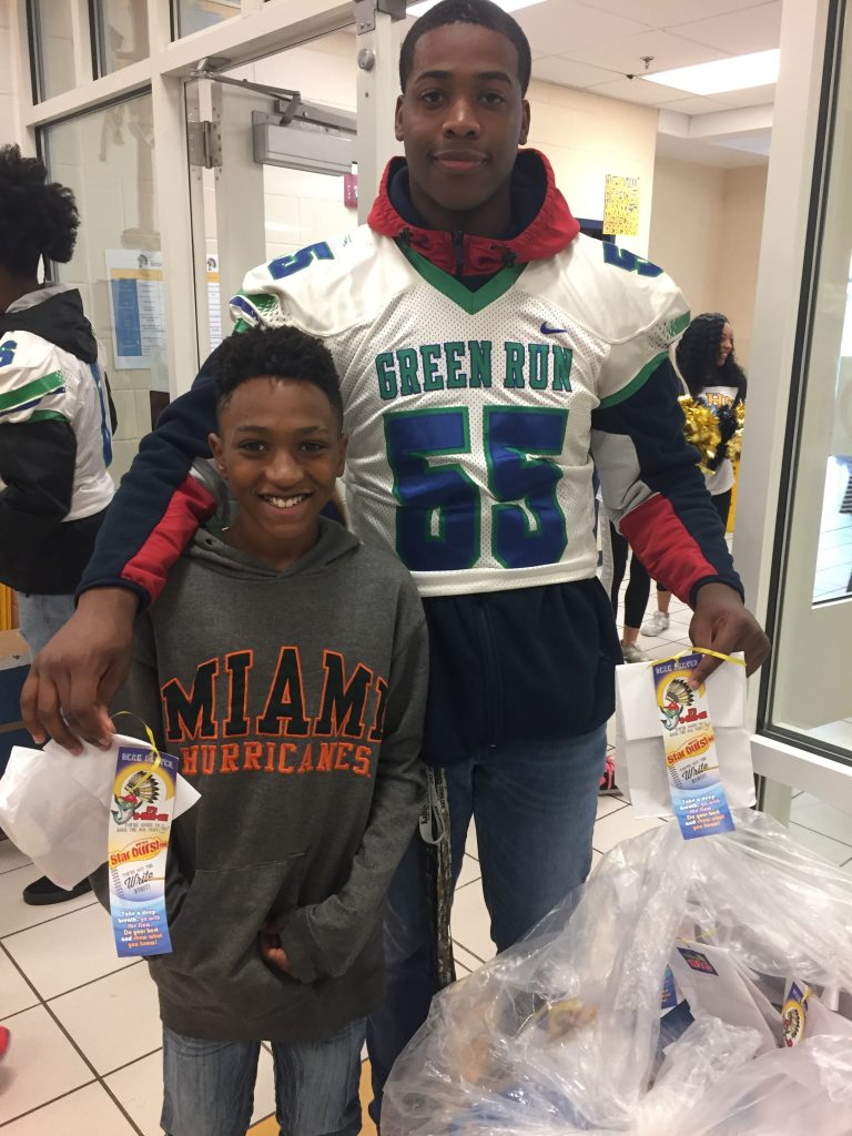 Green Run High School's rising senior and football player number 55, Brison Cole, gave some encouragement to Brookwood Elementary's fourth grader De'andrick Gash before his SOL tests.
