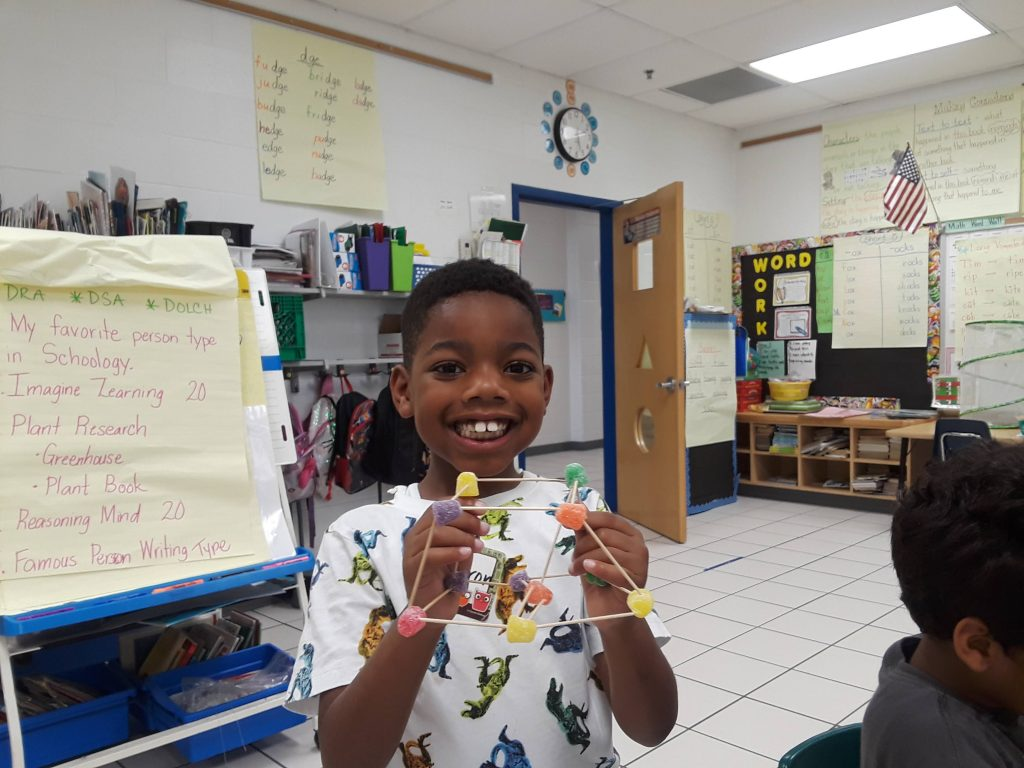 Diamond Springs Elementary School first grader Ayden Matthews shows off his STEM- project gumdrop structure.