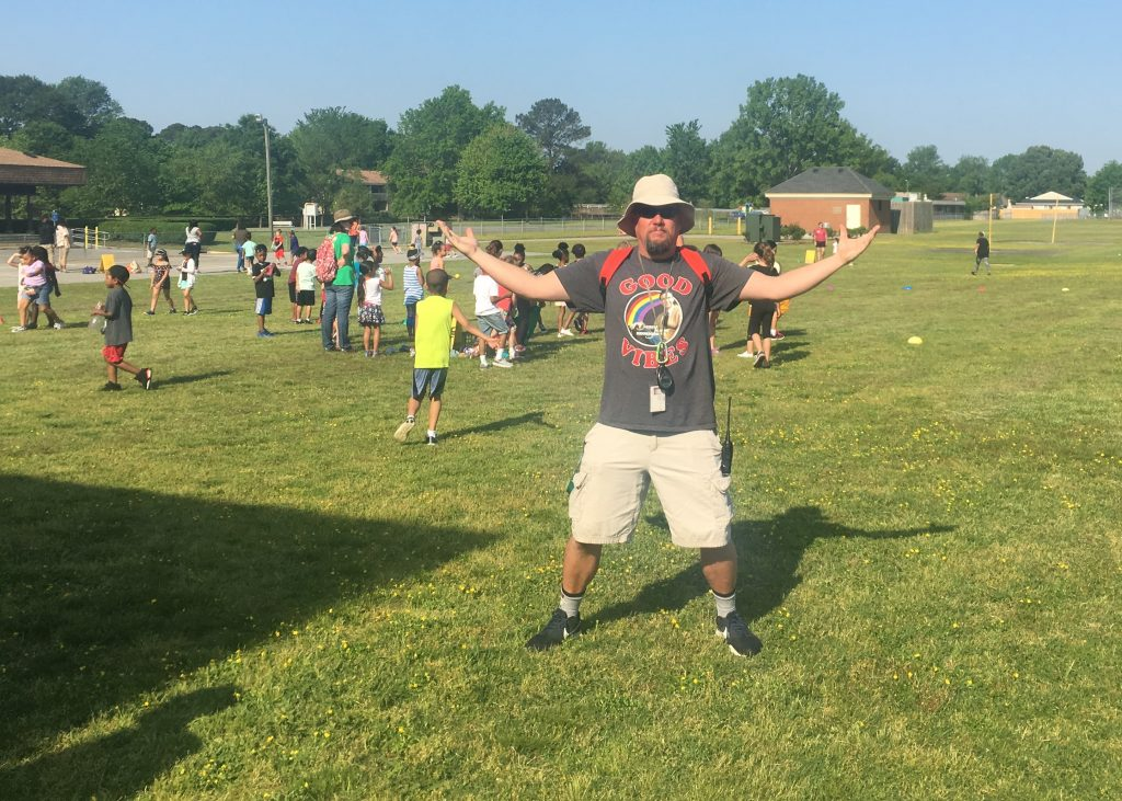 Green Run Elementary PE teacher Howie Conger shows off the field that he set up for field day.