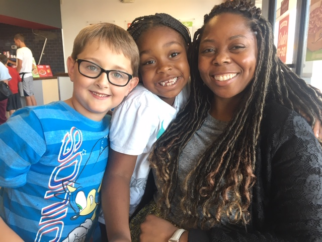 Green Run Elementary students Adam Fischer and Tiauanna Lassiter pose with guidance counselor Rebecca PIerre-Louis during a school fundraiser at CiCi's pizza