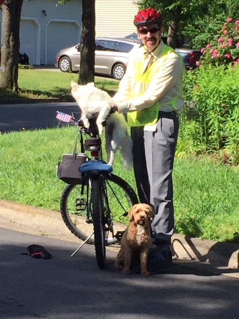 "Mr. ""D,"" a science teacher at Kempsville Middle School, was riding to work the other morning when he had to take a small detour and rescue two stray pups that were running around in the middle of the street."