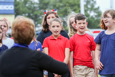 New Castle Elementary's 4th and 5th grade chorus sang the National Anthem at Sunday's Tides baseball game.