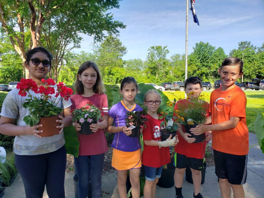 Tanvitha Kondeypati, Lucy Scarbo, Jillian Gatz, Sadie Follin, Ari Cohen and Josh Lichty bought plants at North Landing Elementary School's PTA plant sale.