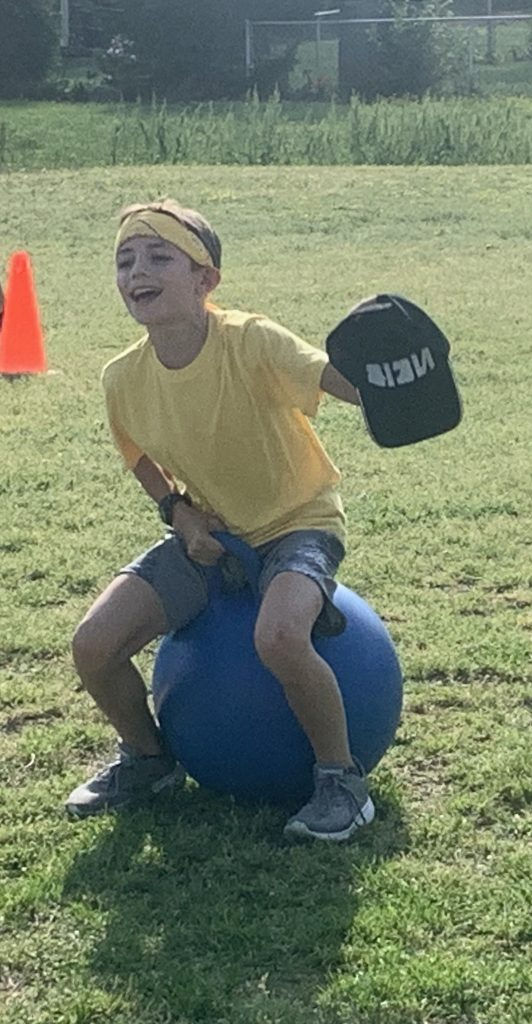 Providence Pioneers participated in Field Day, where Jonathan Teeling completed the Hippity Hop Relay race.