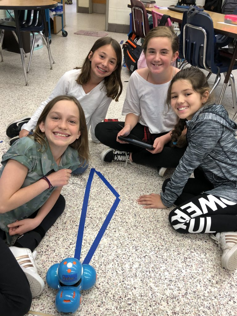 Tabitha Deisch, Adyson Hoock, Carleigh Porter, and Mackenzie Lemn successfully coded their Dash robot to follow the edges of their scalene triangle.