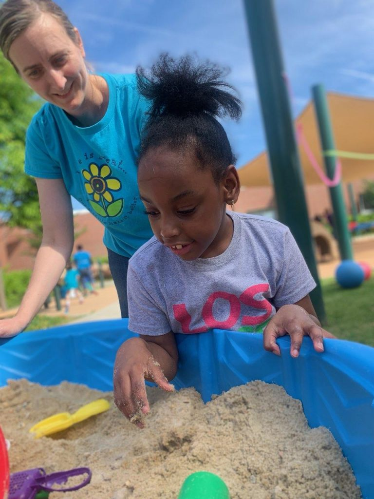 One of Morgyn Pearson's favorite parts of Pembroke Elementary's field day was the sand table. She was all smiles while working and playing with physical therapist Kasey Sabo.