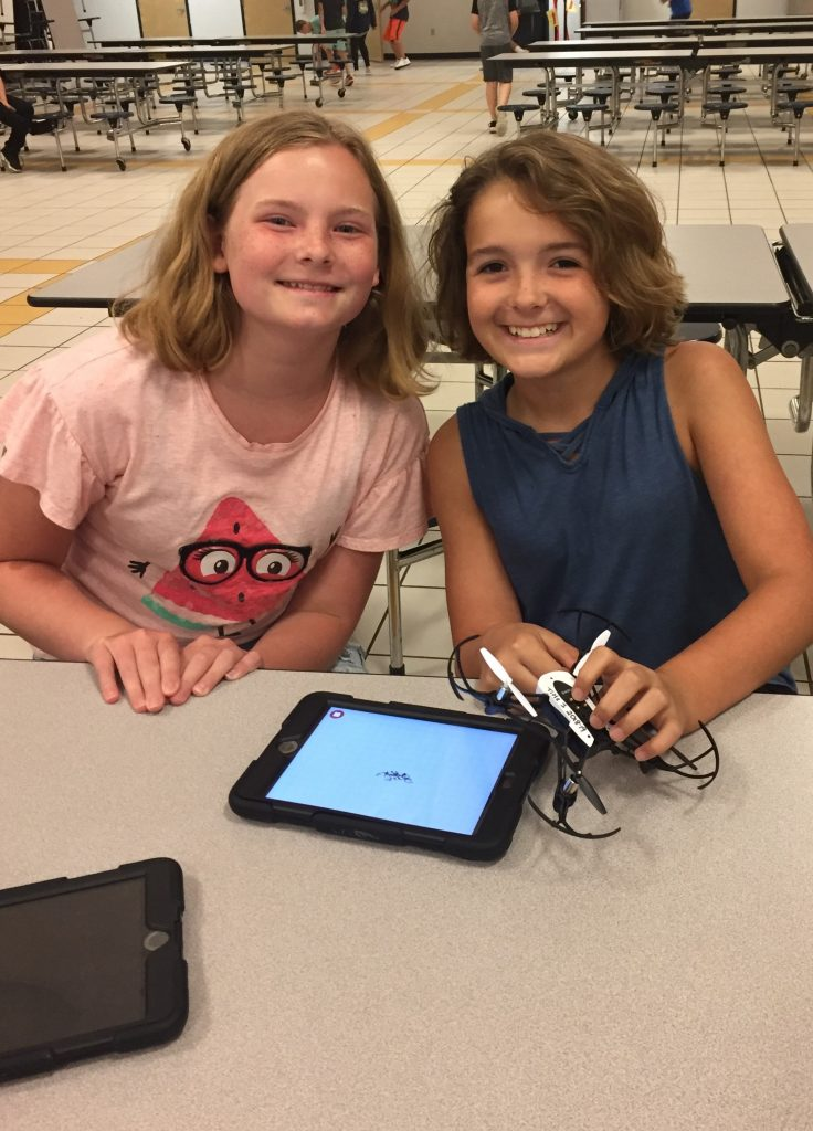 Brookwood Elementary School fifth graders Alexiah Gilliam and Peyton Stallings used block programming to pilot drones through an obstacle course.