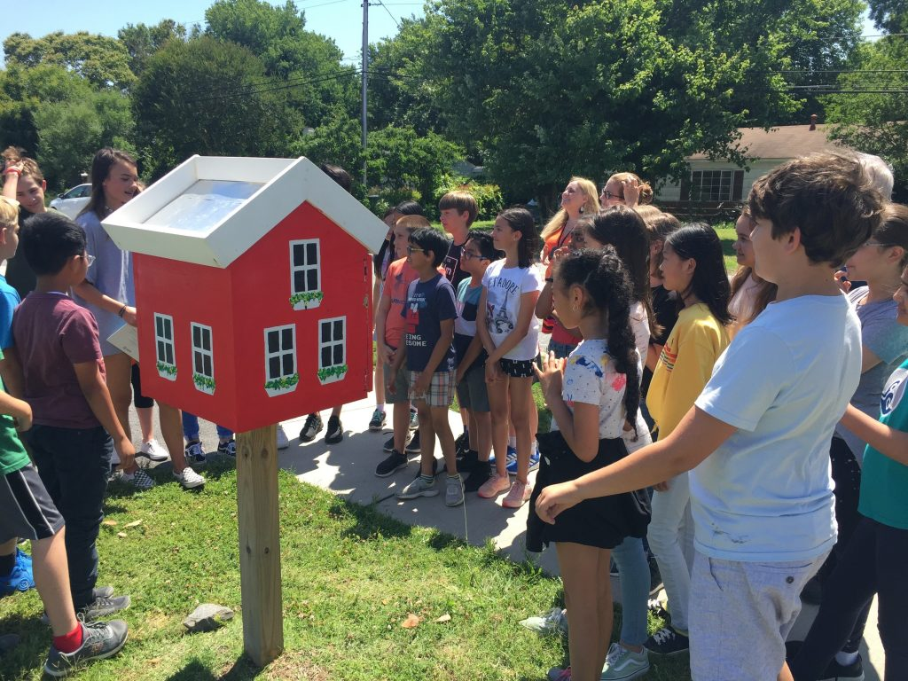 The Aragona Village neighborhood Little Free Library was in disrepair due to water damage, so Old Donation School students and staff took on the task of rebuilding and restocking it.